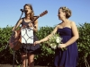 The sister and bridesmaid sing a sweet song for the bride