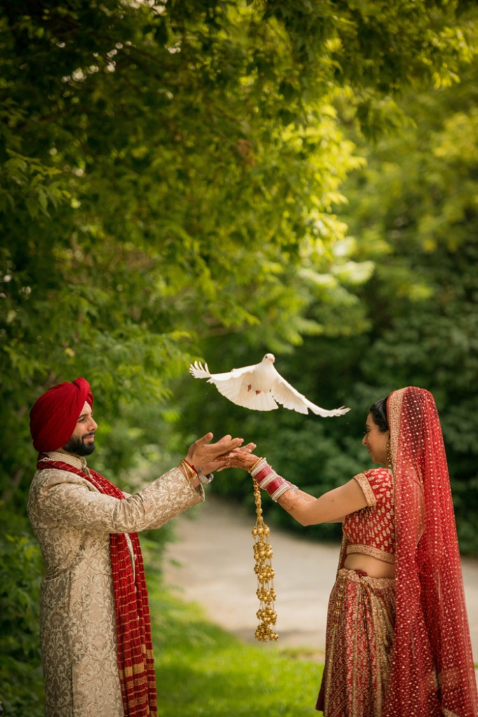 Bride and groom release a dove. www.rebeccachan.ca