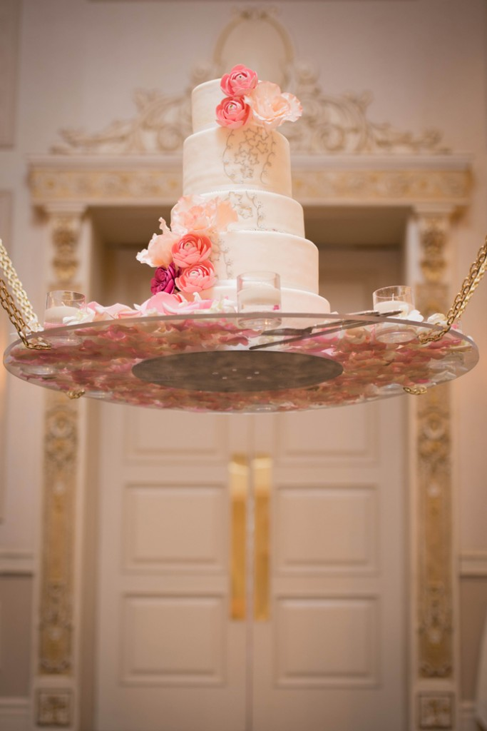 Suspended wedding cake with pink handcrafted flowers. www.rebeccachan.ca