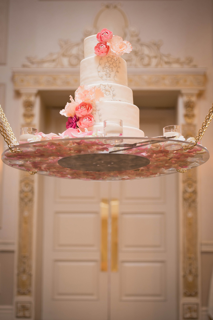 Suspended pink floral wedding cake. See more at Rebecca Chan Weddings and Events http://www.rebeccachan.ca