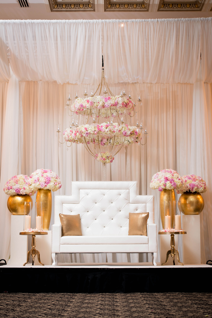 Custom floral chandelier with white and gold head table. See more at Rebecca Chan Weddings and Events http://www.rebeccachan.ca