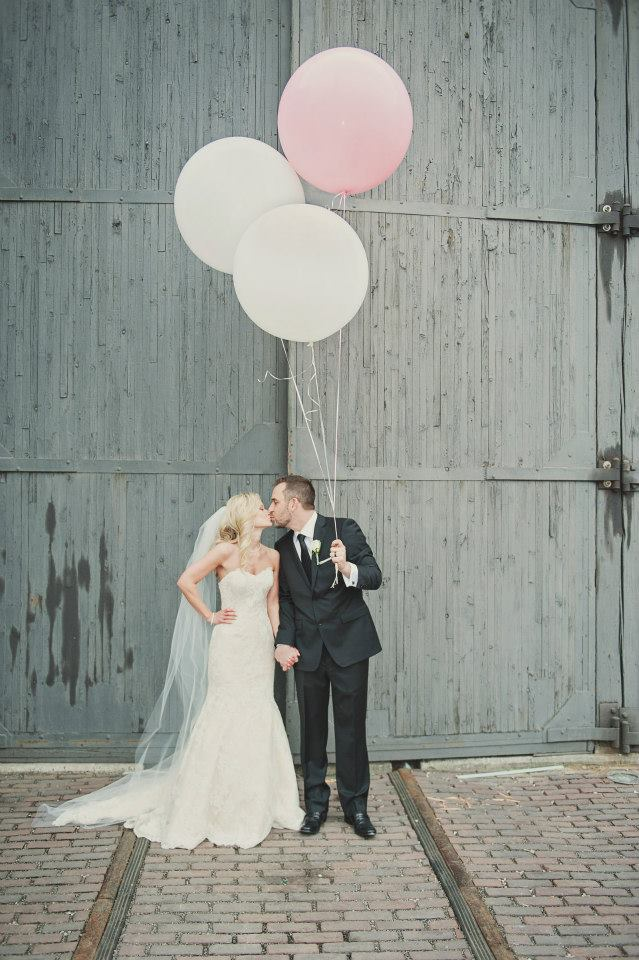 The bride and groom take fun photos with giant balloons. See more at Rebecca Chan Weddings and Events http://www.rebeccachan.ca