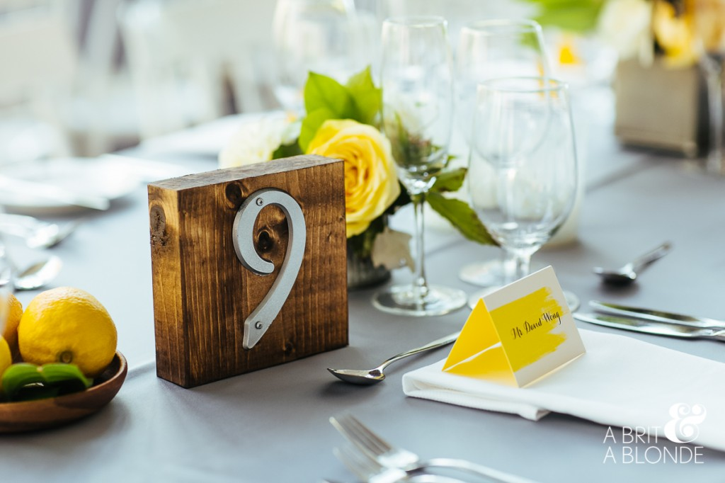 Custom wedding table numbers, lemon accents and table cards by Paleterra