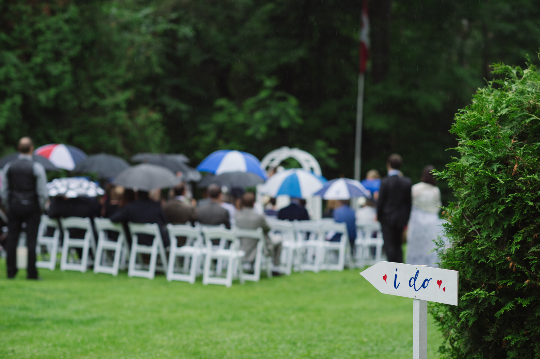 Backyard tented Ontario wedding ceremony and I Do sign. See more at Rebecca Chan Weddings and Events http://www.rebeccachan.ca