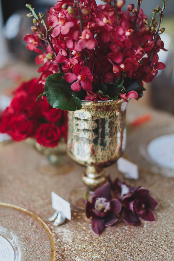 Chic Gold and Red Chinese New Year Dinner Party red centrepieces. See more at Rebecca Chan Weddings and Events http://www.rebeccachan.ca