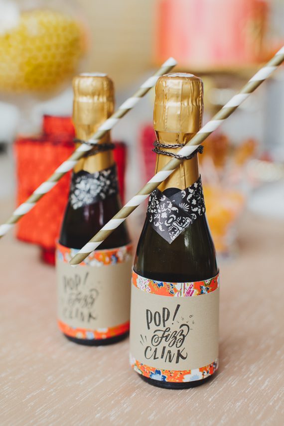 Chic Gold and Red Chinese New Year Dinner Party favours - mini champagne bottles. See more at Rebecca Chan Weddings and Events http://www.rebeccachan.ca