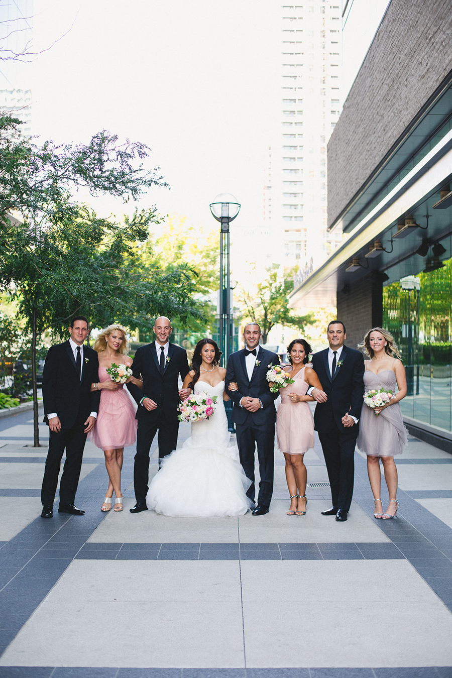 Bride with mismatched pink bridesmaids dresses. See more at Rebecca Chan Weddings and Events: http://www.rebeccachan.ca