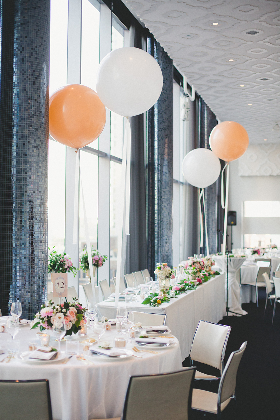 Lush pink floral and blush balloons at Malaparte, Toronto. See more at Rebecca Chan Weddings and Events: http://www.rebeccachan.ca
