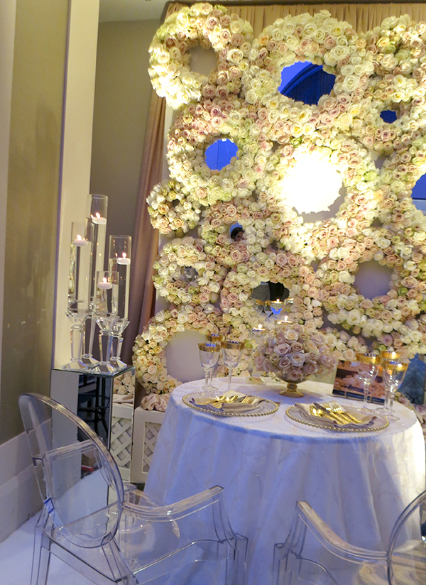 A graphic yet ethereal flower wall made of round wreaths, from FOS Decor Center. Bold Floral and Floral Cake Ideas from the Wedluxe Show 2015. For more ideas, visit Rebecca Chan Weddings and Events at www.rebeccachan.ca