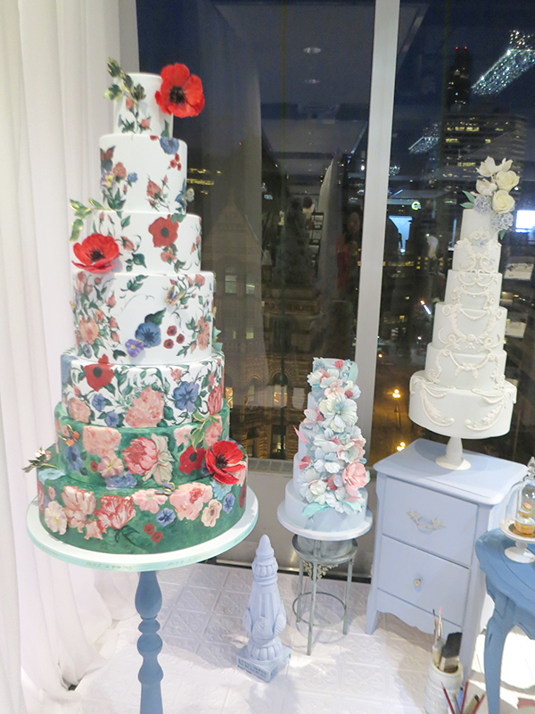 Hand-painted floral on this beautiful 7-tier cake from Nadia & Co. Bold Floral and Floral Cake Ideas from the Wedluxe Show 2015. For more ideas, visit Rebecca Chan Weddings and Events at www.rebeccachan.ca