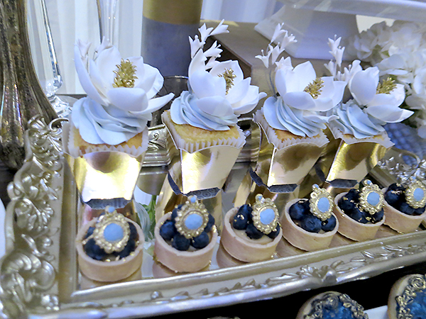 Delicate sugar flowers on square cupcakes, displayed in gold ornate frame. From Truffle Cake & Pastry. Bold Floral and Floral Cake Ideas from the Wedluxe Show 2015. For more ideas, visit Rebecca Chan Weddings and Events at www.rebeccachan.ca