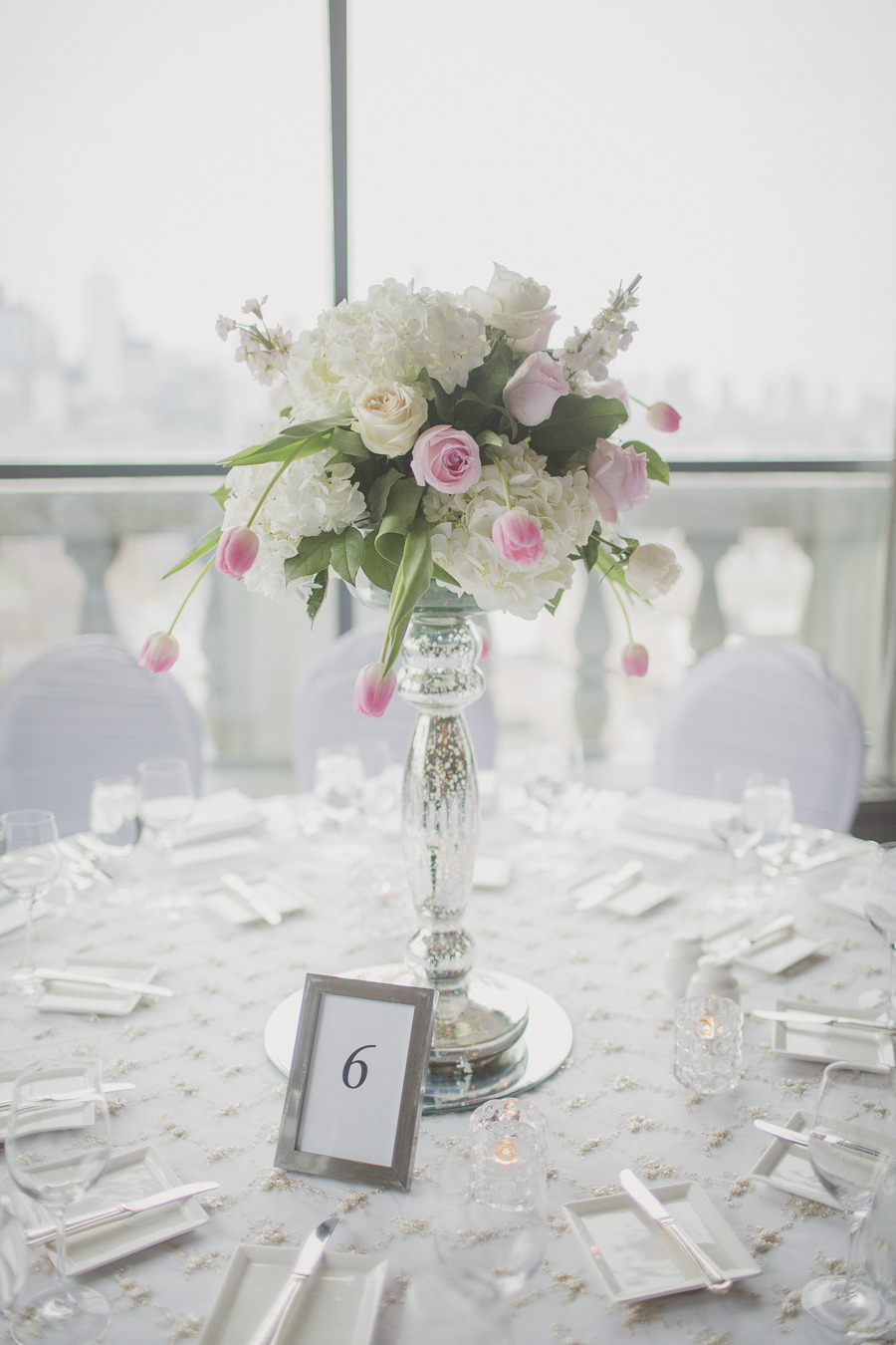 Romantic and modern white and pink centrepieces. See more at Rebecca Chan Weddings and Events http://www.rebeccachan.ca