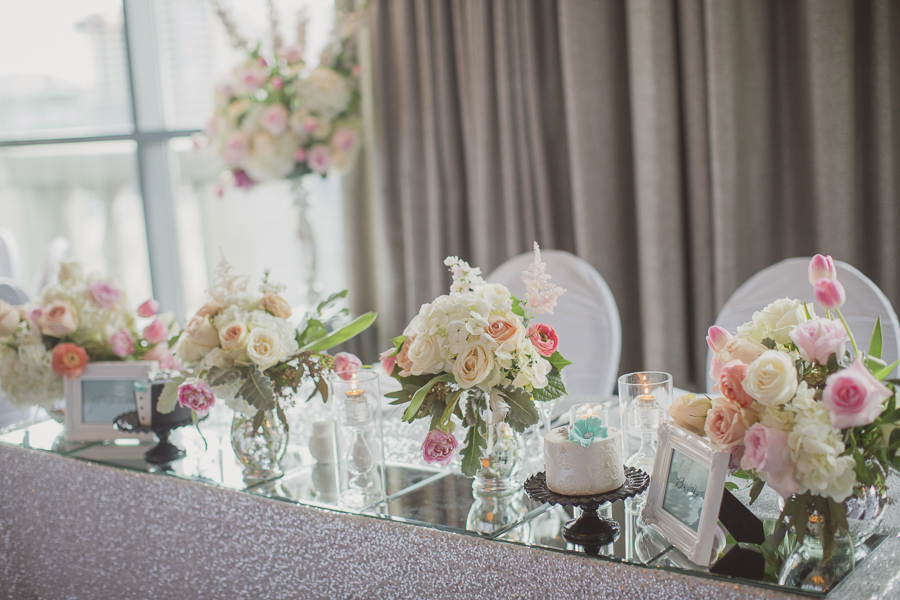Head table with silver sequinned linen, blush floral and Tiffany-blue accents. See more at Rebecca Chan Weddings and Events http://www.rebeccachan.ca