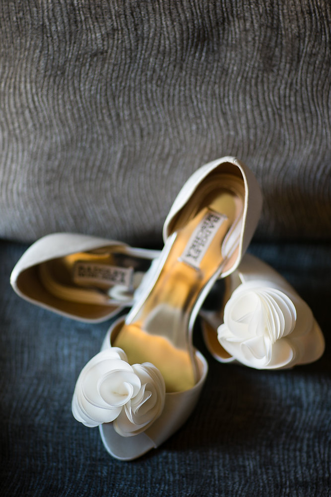 Bride's Badgley Mischka shoes at a classic ivory and champagne wedding at Liberty Grand. See more at Rebecca Chan Weddings and Events http://www.rebeccachan.ca