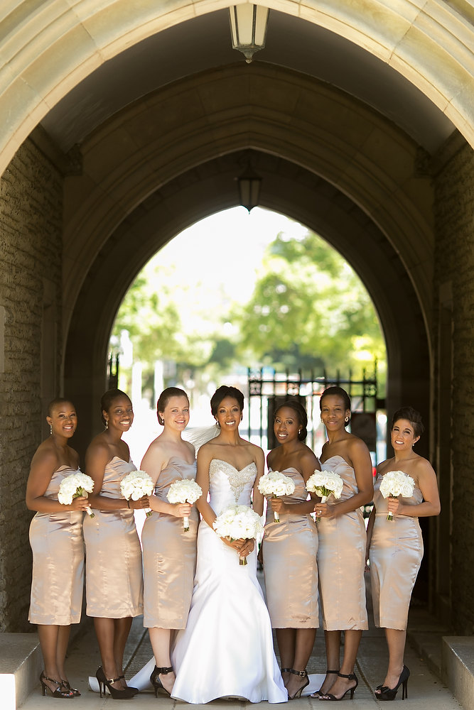 Classic ivory and champagne wedding colours - bride with her bridesmaids. See more at Rebecca Chan Weddings and Events http://www.rebeccachan.ca