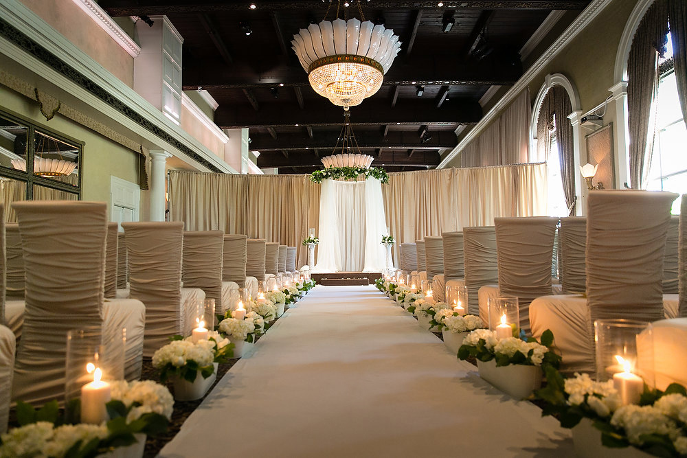 Classic ivory and champagne wedding ceremony at Liberty Grand. See more at Rebecca Chan Weddings and Events http://www.rebeccachan.ca
