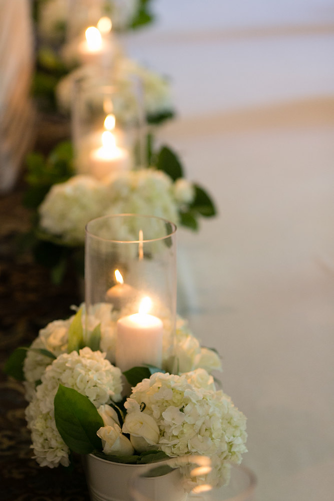Classic ivory and champagne wedding ceremony decor lining the aisle at Liberty Grand. See more at Rebecca Chan Weddings and Events http://www.rebeccachan.ca