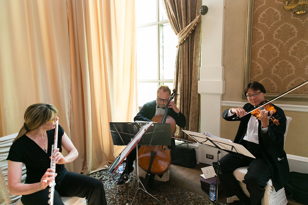 Classic ivory and champagne wedding string quartet at Liberty Grand. See more at Rebecca Chan Weddings and Events http://www.rebeccachan.ca