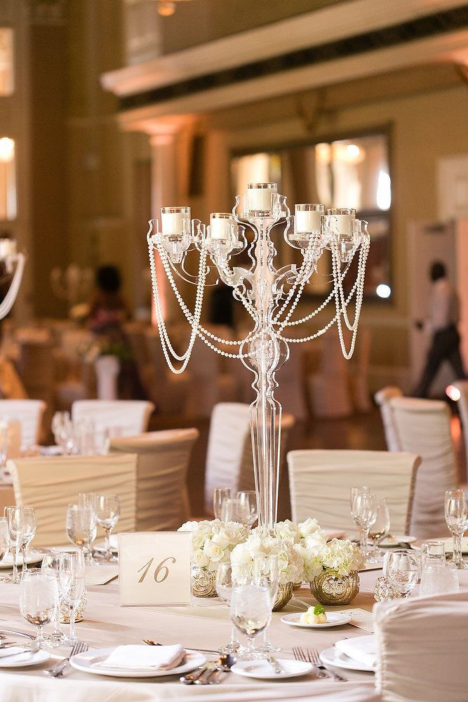 Classic ivory and champagne wedding centrepiece at Liberty Grand. See more at Rebecca Chan Weddings and Events http://www.rebeccachan.ca
