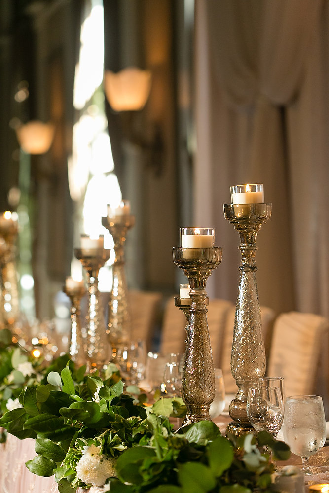 Classic ivory and champagne wedding head table pillar candles at Liberty Grand. See more at Rebecca Chan Weddings and Events http://www.rebeccachan.ca