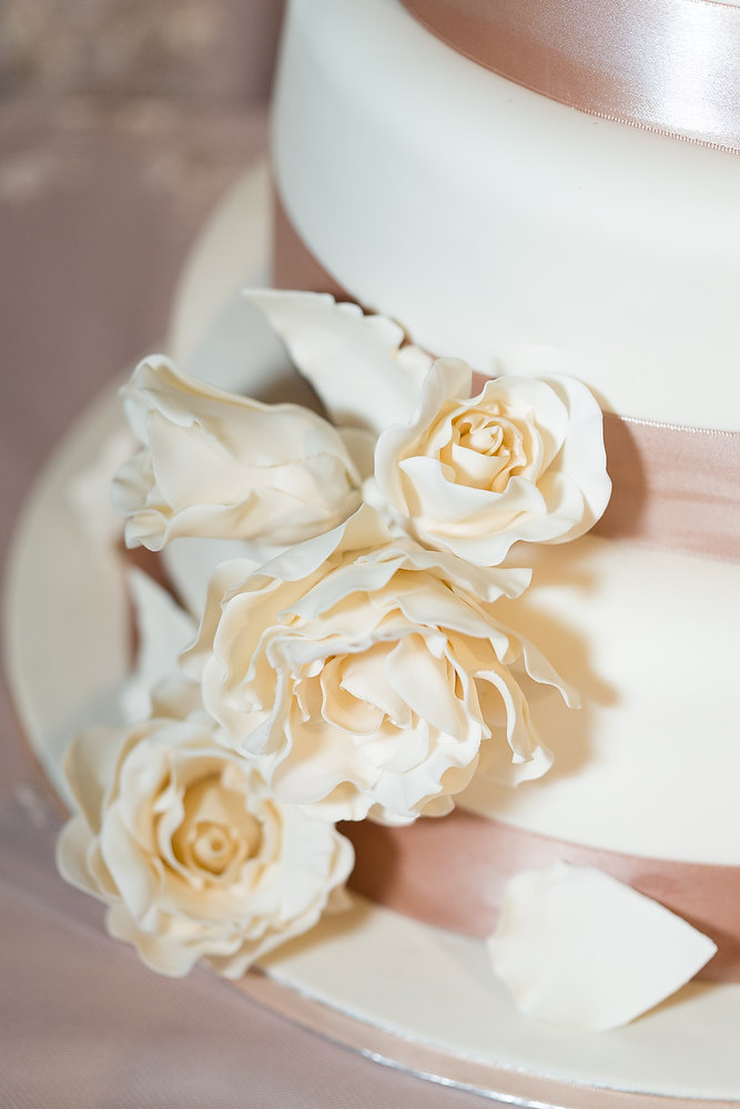Classic ivory and champagne wedding cake at Liberty Grand. See more at Rebecca Chan Weddings and Events http://www.rebeccachan.ca
