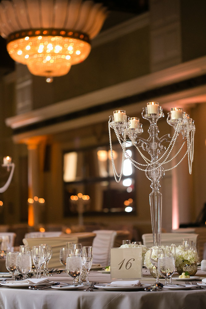 Classic ivory and champagne wedding centrepiece from Have A Seat at Liberty Grand. See more at Rebecca Chan Weddings and Events http://www.rebeccachan.ca