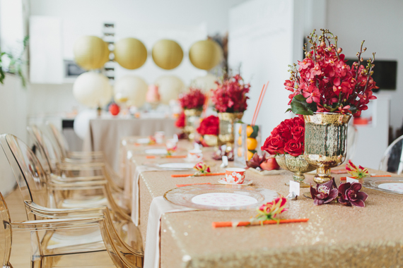Gold ghost chairs. Chic Gold and Red Chinese New Year Inspired Dinner Party. See more at Rebecca Chan Weddings and Events http://www.rebeccachan.ca