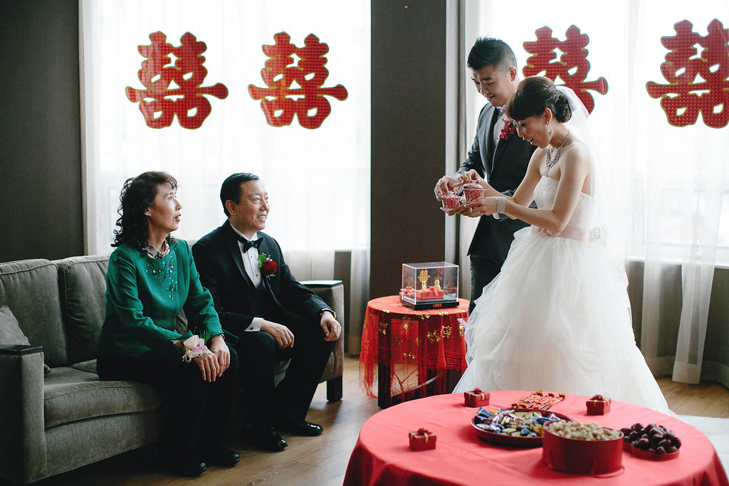 Chinese Wedding Gift For Groom : Bride and groom at their tea ceremony at their modern Chinese wedding ...