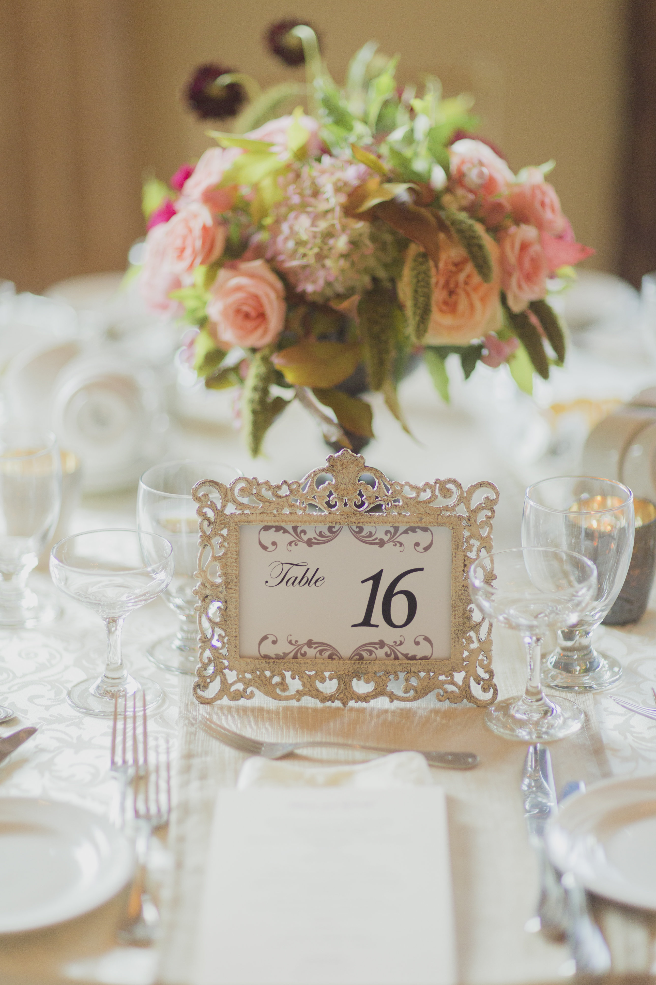 Romantic cranberry and blush floral centrepiece and gold framed table number. See more at Rebecca Chan Weddings and Events http://www.rebeccachan.ca