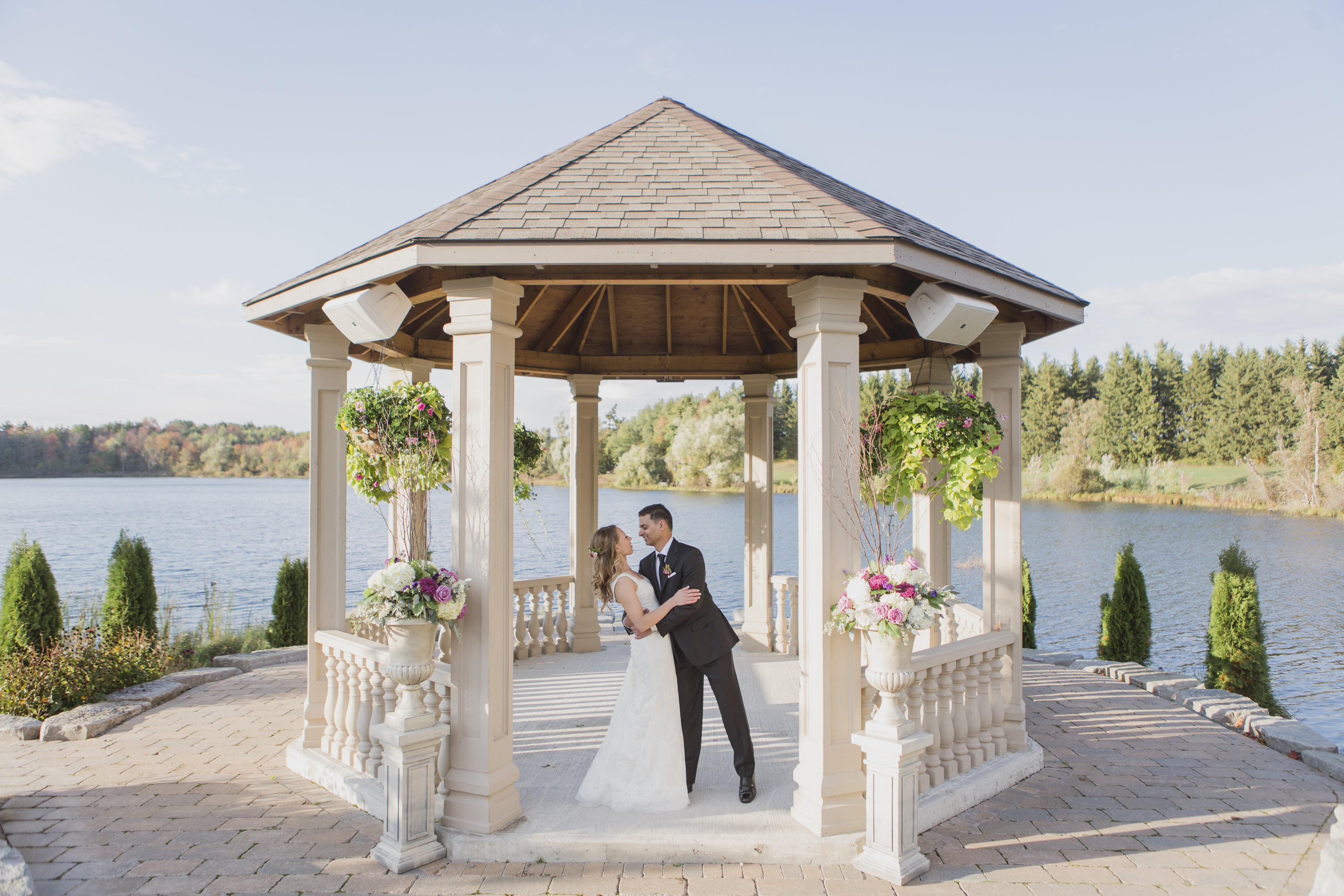 Fall wedding photos under a gazebo in Ontario. See more at Rebecca Chan Weddings and Events http://www.rebeccachan.ca