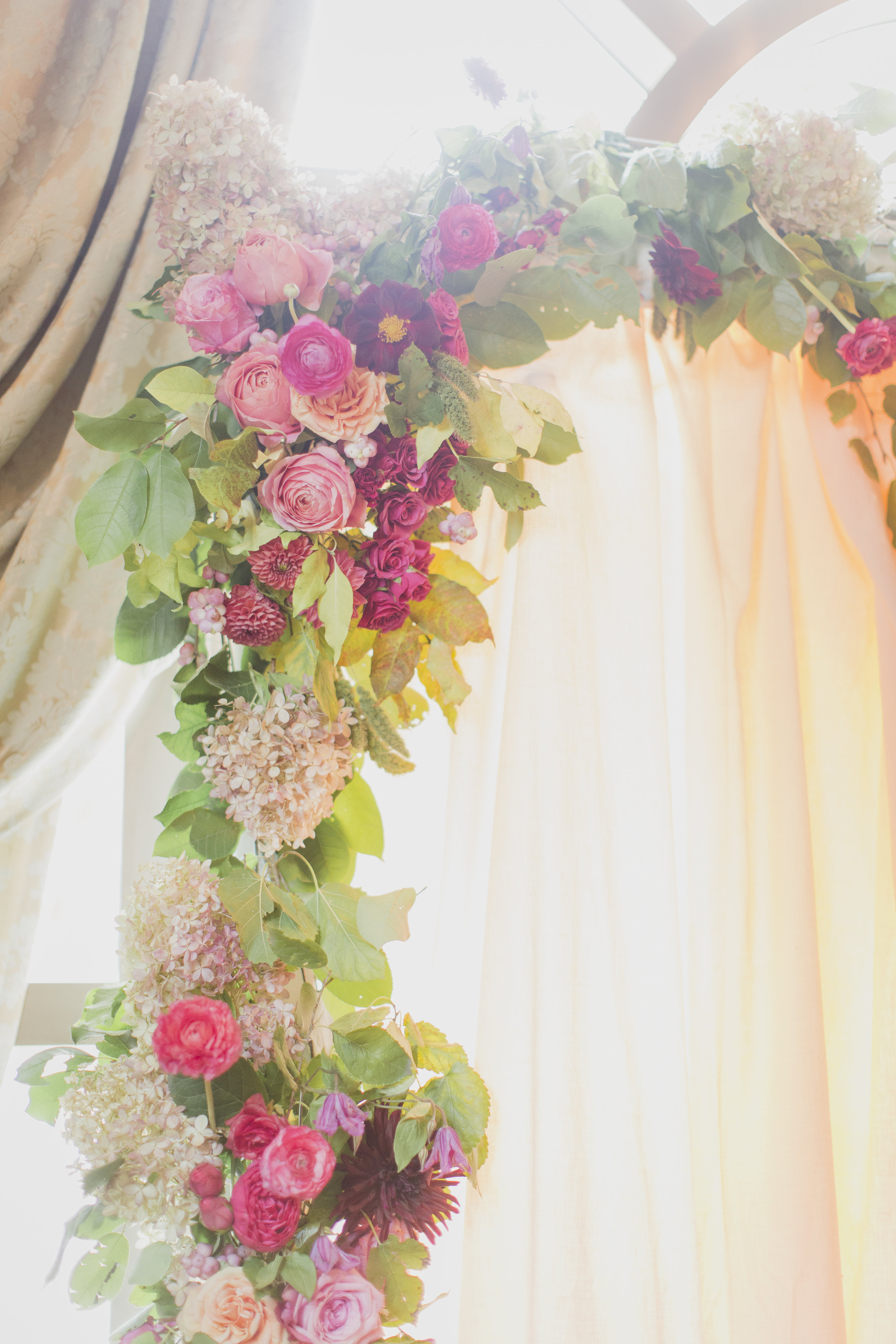 Romantic cranberry and blush floral garland for the wedding ceremony. See more at Rebecca Chan Weddings and Events http://www.rebeccachan.ca