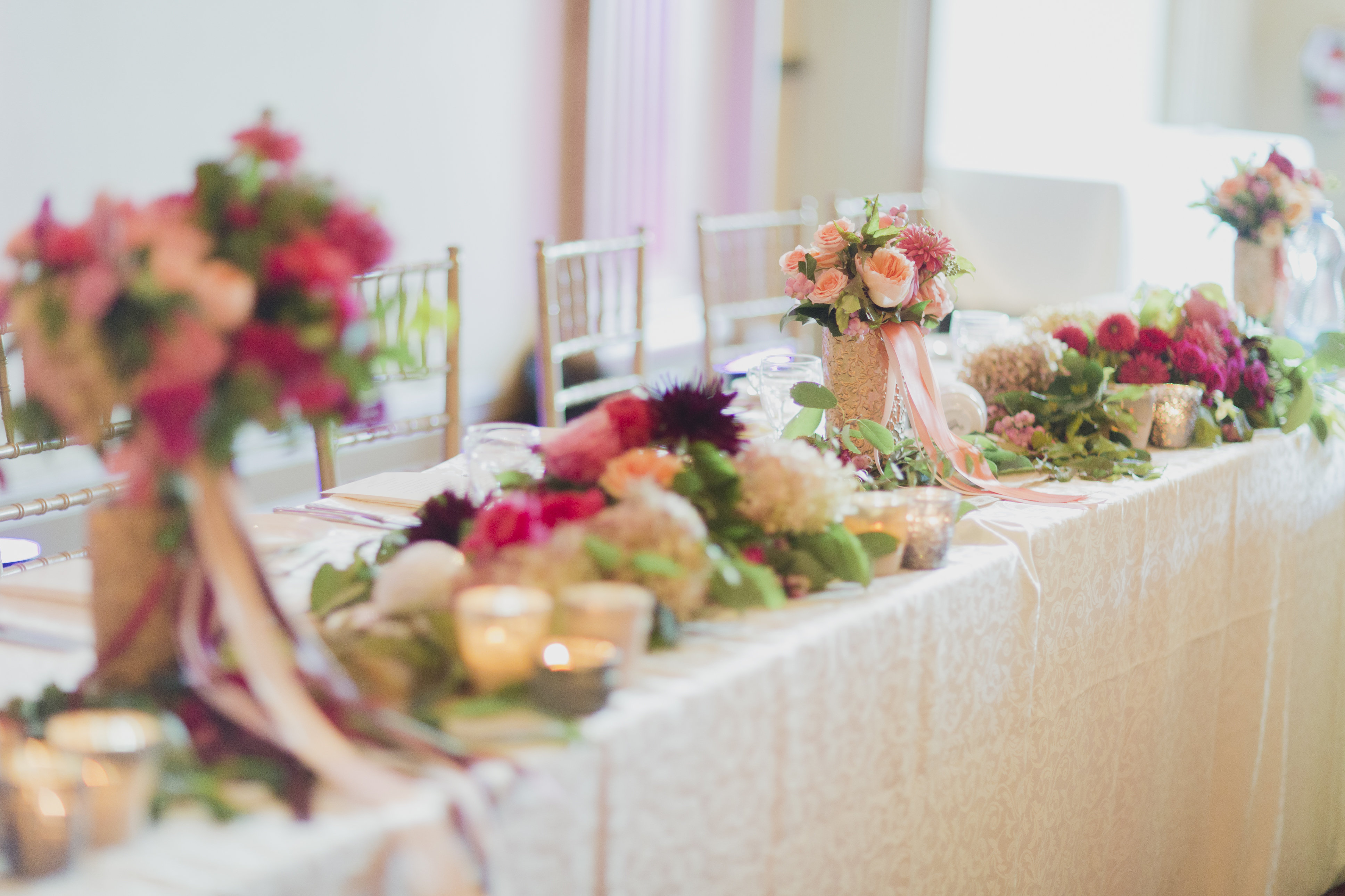Romantic cranberry and blush floral garland at the head table. See more at Rebecca Chan Weddings and Events http://www.rebeccachan.ca