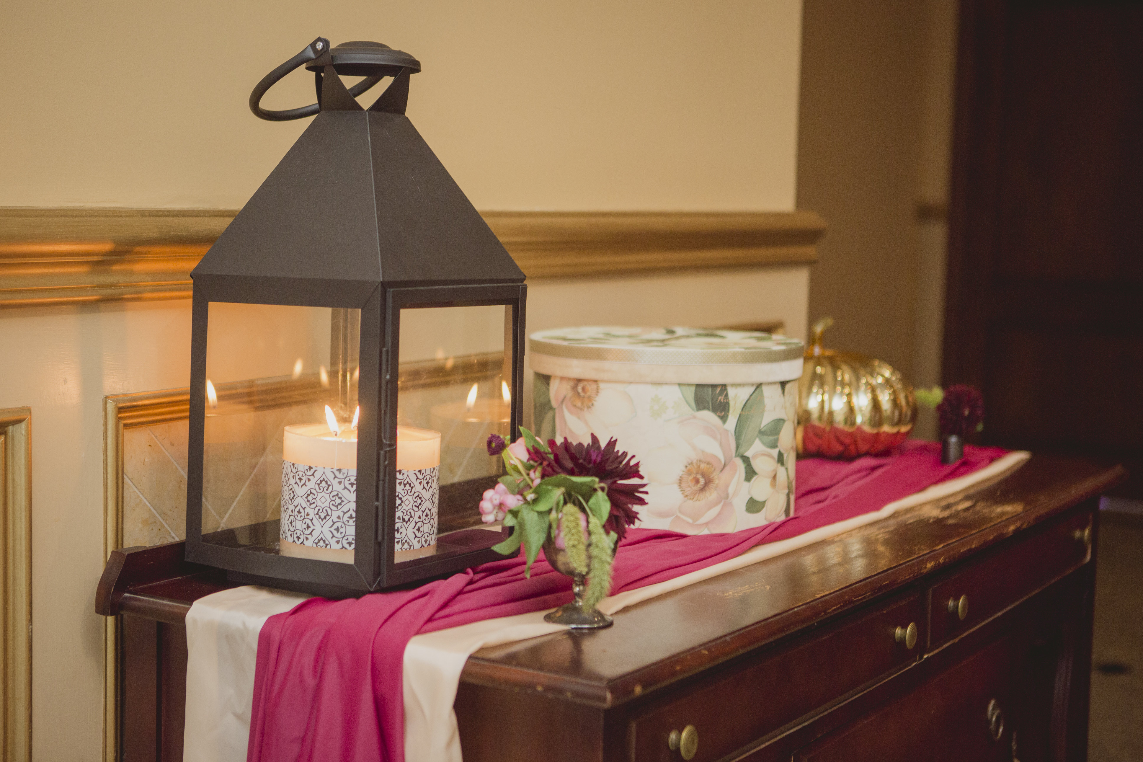 Romantic cranberry and blush receiving table. See more at Rebecca Chan Weddings and Events http://www.rebeccachan.ca