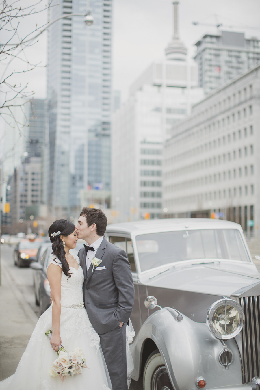 Bride and groom pose outside their Rolls Royce. See more at Rebecca Chan Weddings and Events http://www.rebeccachan.ca