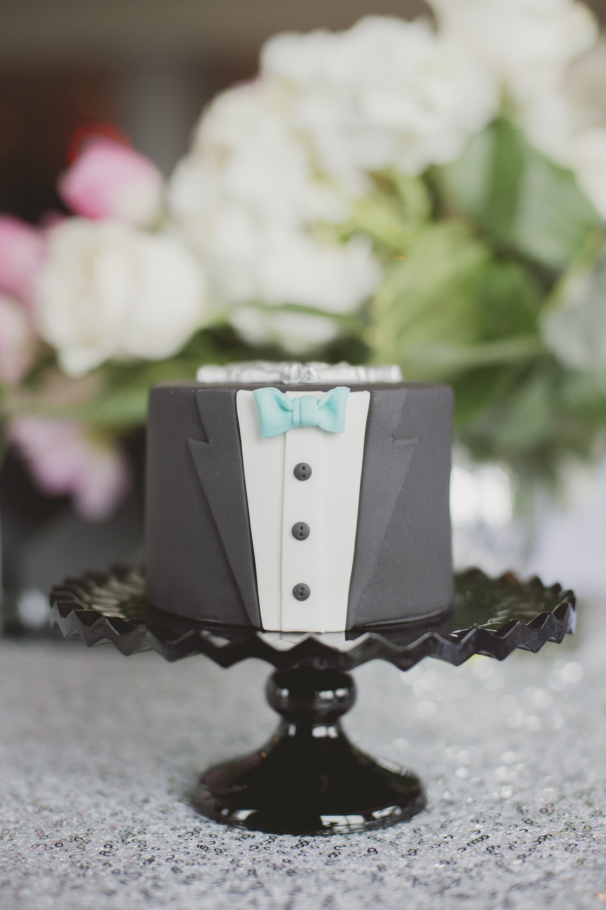 Groom's mini cake with Tiffany-blue bowtie. See more at Rebecca Chan Weddings and Events http://www.rebeccachan.ca