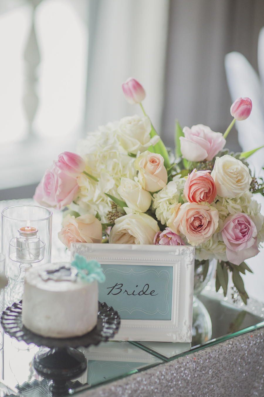 Framed bride sign with pink and peach floral at sweet heart table. See more at Rebecca Chan Weddings and Events http://www.rebeccachan.ca