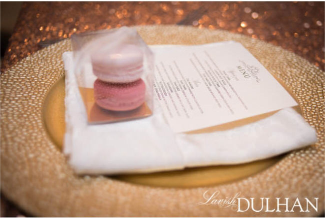 Gold place setting with pink macaron favours. See more at Rebecca Chan Weddings and Events http://www.rebeccachan.ca