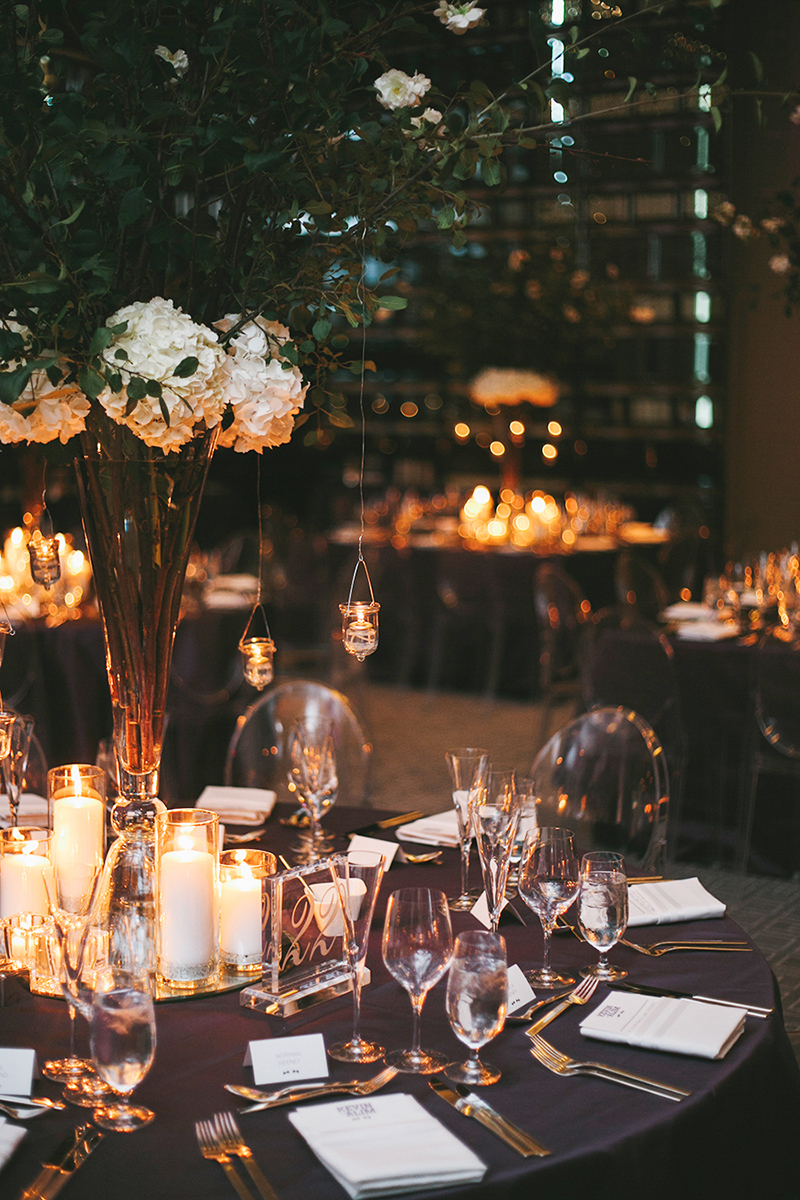 Ethereal centrepieces with hanging votives fit for a modern black-tie affair, as seen in Wedluxe. Planner: Rebecca Chan Weddings and Events www.rebeccachan.ca To see more, visit www.rebeccachan.ca