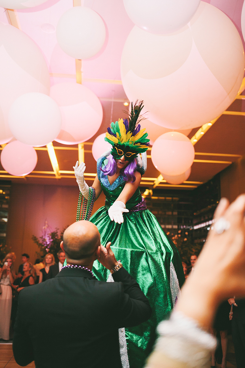 Stilt walkers hand out masks and beads at this wedding reception, as seen in Wedluxe. Planner: Rebecca Chan Weddings and Events www.rebeccachan.ca To see more, visit www.rebeccachan.ca