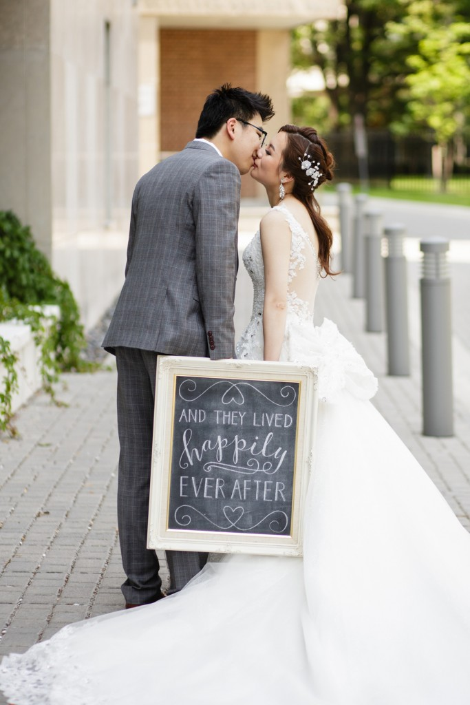 Bride and groom with happily ever after sign - Romantic blush pink wedding at Ritz-Carlton Hotel Toronto