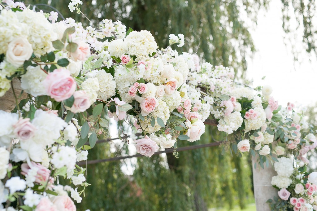 Blush Pink Ontario Winery wedding - Intimate ceremony with lush floral garland arch