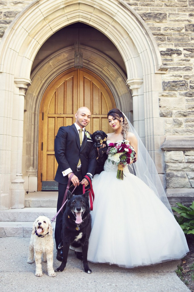 Elegant vintage-inspired purple and gold wedding - Photo with their three dogs