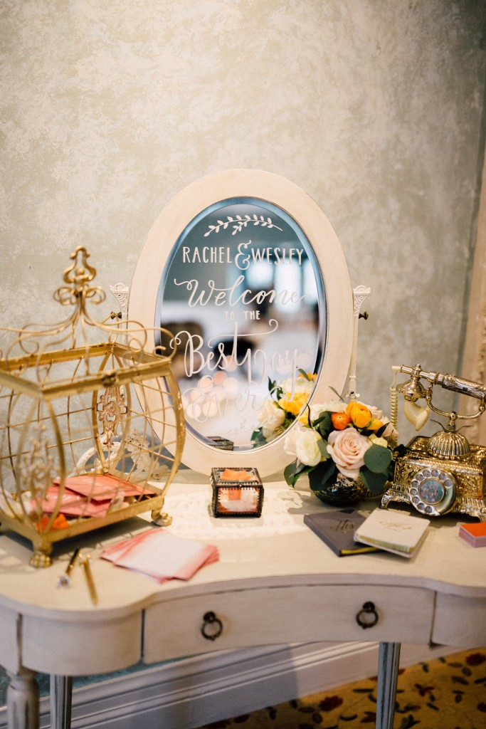 Estates of Sunnybrook indoor ceremony inspiration - welcome table vanity and mirror calligraphy