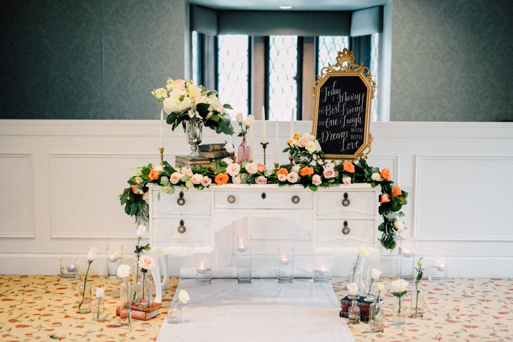 Estates of Sunnybrook indoor ceremony inspiration - floral garland and vintage vanity