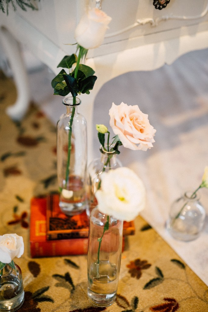 Estates of Sunnybrook indoor ceremony inspiration - vintage bottles with single bloom