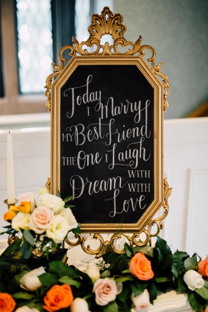 Estates of Sunnybrook indoor ceremony inspiration - gold calligraphy wedding sign