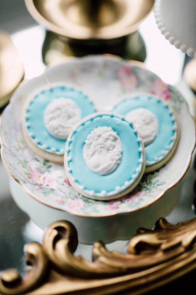 Estates of Sunnybrook indoor ceremony inspiration - vintage saucer with cookies