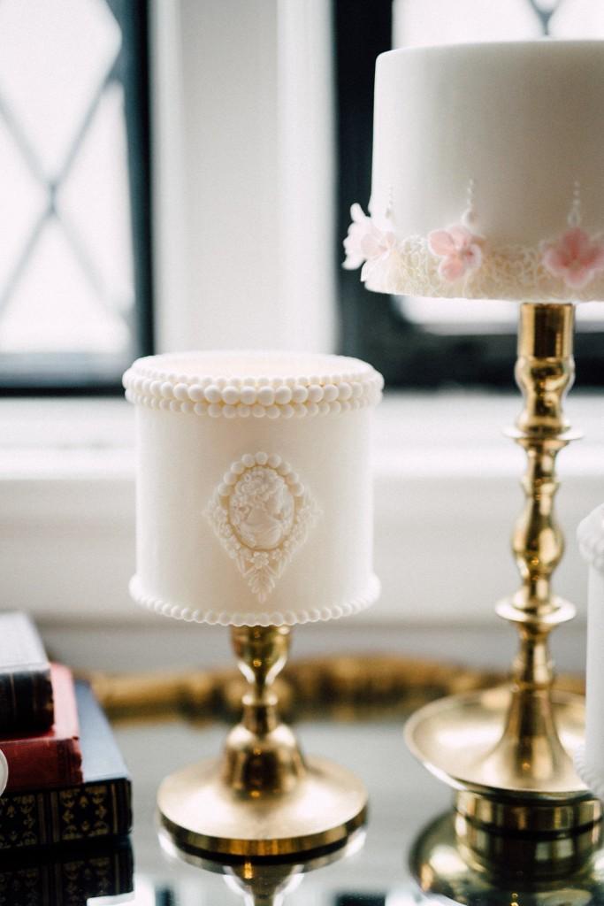 Estates of Sunnybrook indoor ceremony inspiration - brass candlesticks and mini cakes