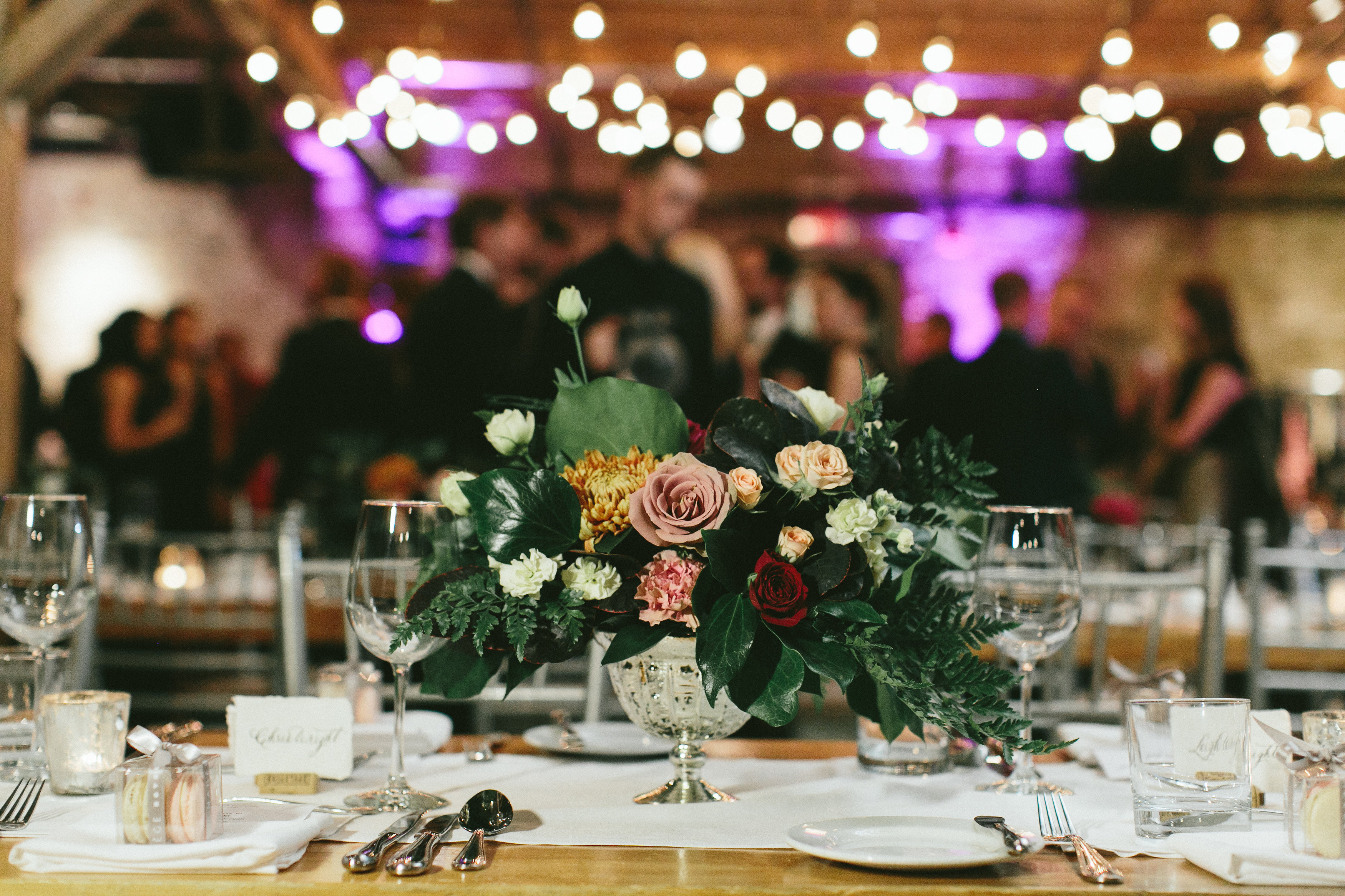 Elegant and Rustic Toronto Wedding in the Distillery District - Organic and loose floral centrepiece