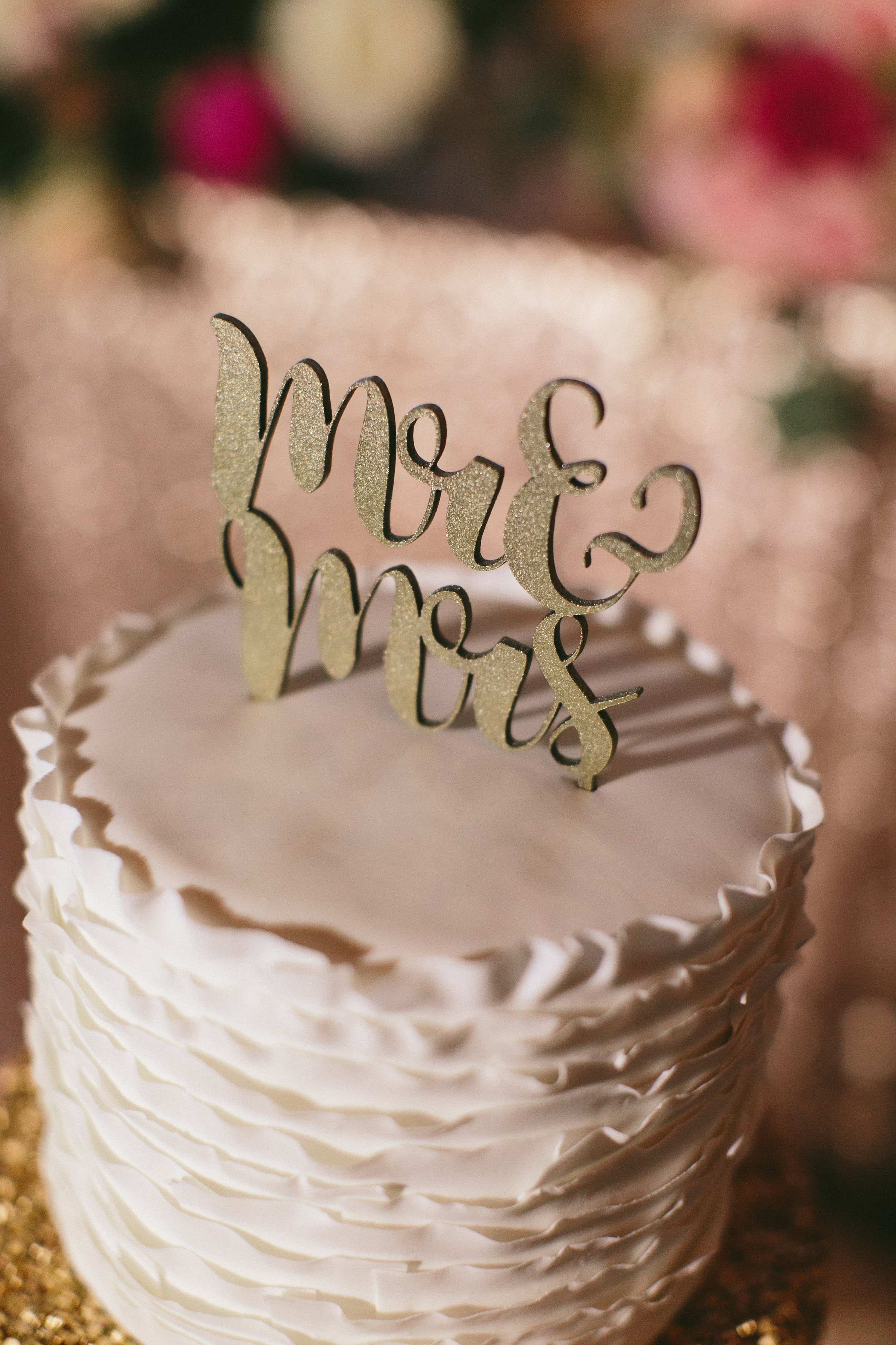 Sophisticated Garden-Inspired Wedding in Toronto at the Grand Luxe - Mr and Mrs cake topper
